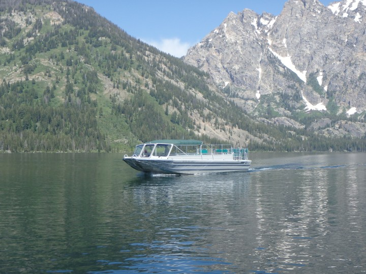 Boats go across Jenny Lake frequently during the day