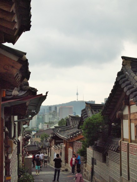 Another view of Bukchon-ro 11-gil from the top of the street with N Seoul Tower in the distance
