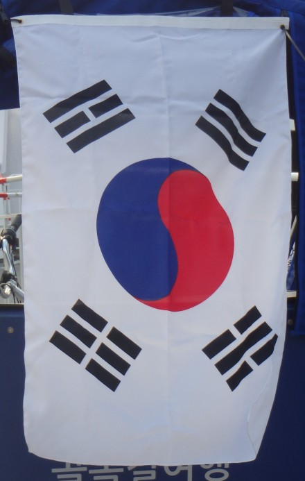 Korea's flag - Taegeukgi. The blue and red yin-yang represents the harmony of opposites and the 4 black trigrams symbolize justice, wisdom, vitality, and fertility. The white background represents purity and peace.