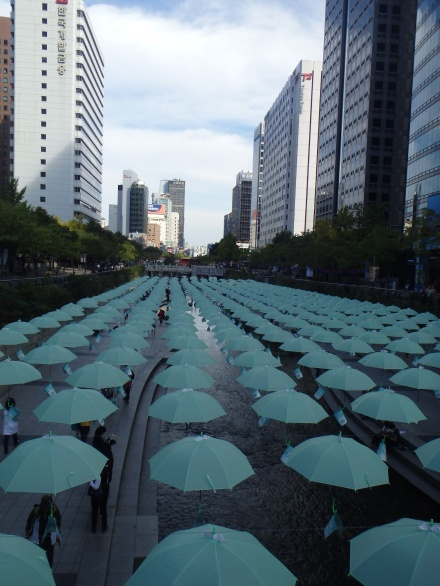 umbrellas suspended over the stream