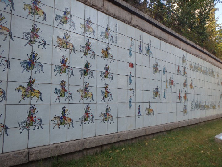 This is a mural of the procession of King Jeongjo and his mother, Queen Hyegyeonggung, going to visit his father's tomb