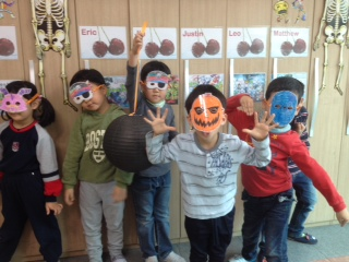 My kinder class in the masks that we made on Thursday