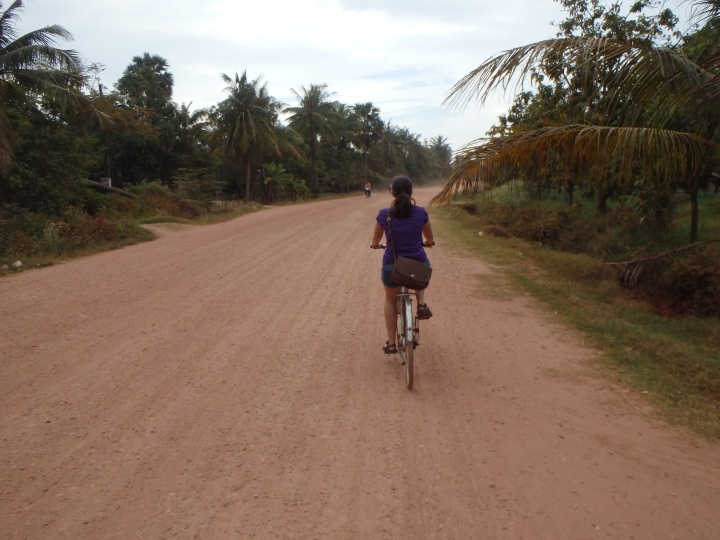 cycling on the dirt road into town