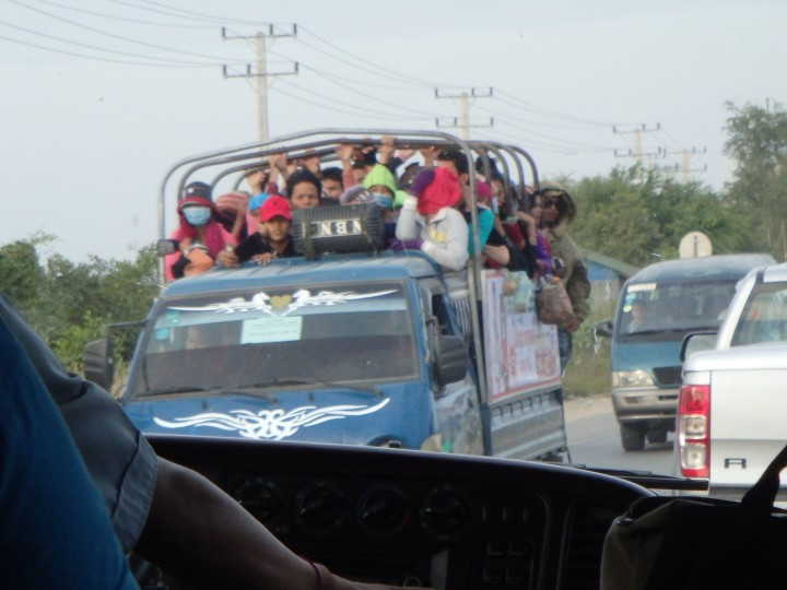 We saw dozens of trucks like this on their way to garment factories...
