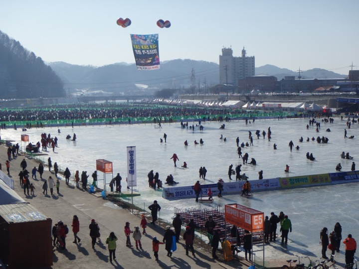 That mass of people in the distance is thousands of Koreans ice fishing