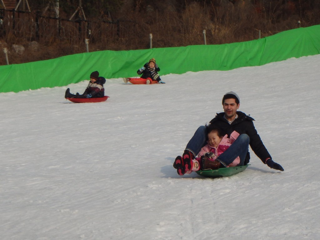 Paul flying down the hill with Jellyna
