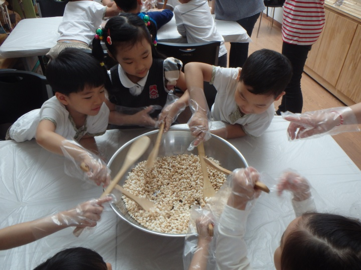 Mixing it all together with the puffed rice