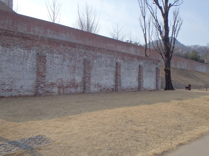The brick wall surrounding the execution building