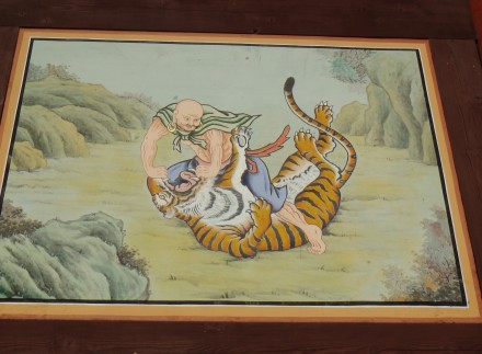 One of the paintings on the side panels