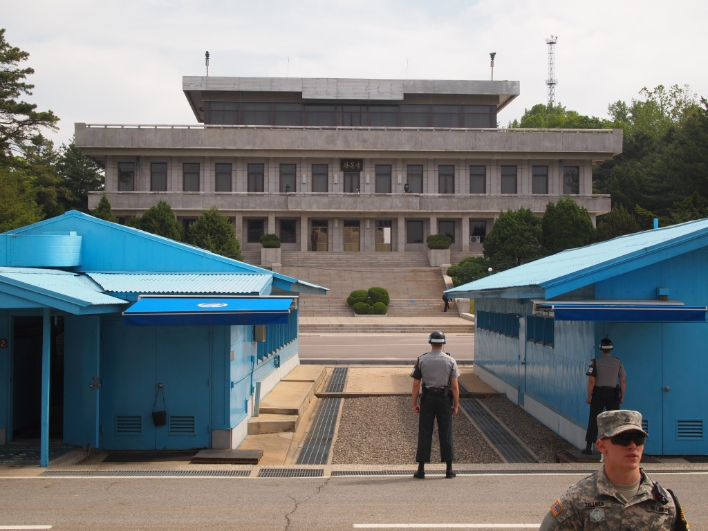 The blue buildings are ROK, the large building is DPRK