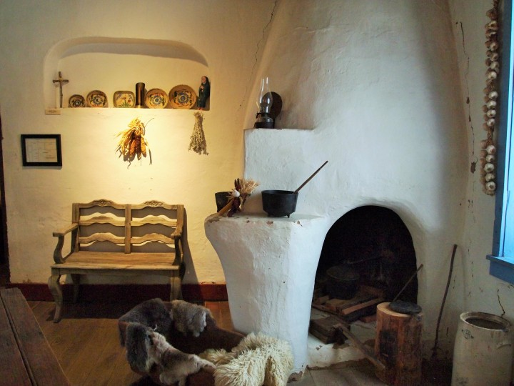 The kitchen had a large kiva fireplace/stove