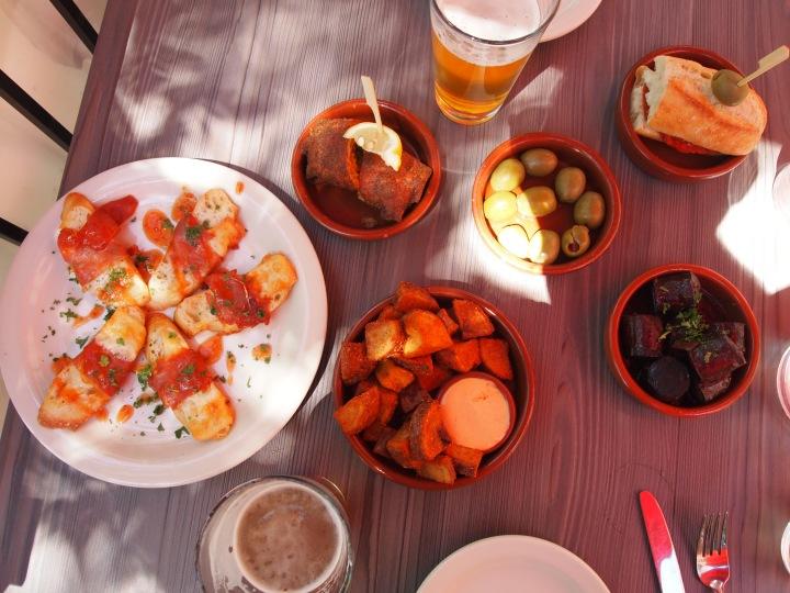 Our pintxos feast - marinated green olives, patatas bravas, paella roll, jamon & manchego toast, chorizo pamplona & manchego sandwich, and Basque meatballs